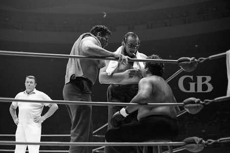 Seconds Gorilla Monsoon and Rocky Montero offer advice to Curtis Iaukea between rounds